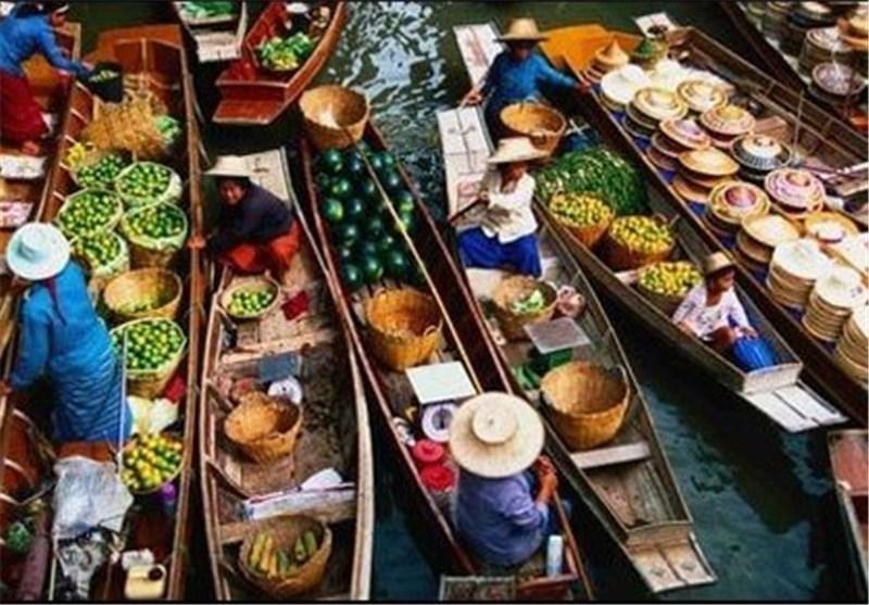 تصاویر بازاری روی آب در تایلند