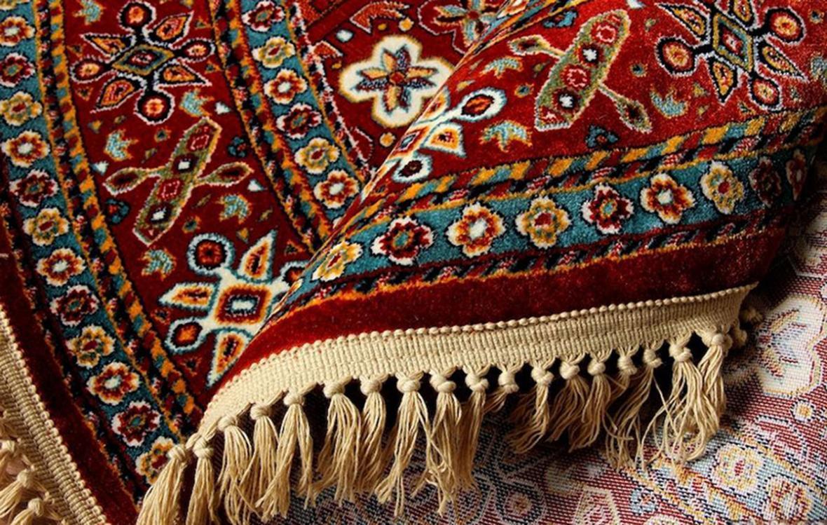 کشف 70 تخته فرش دستباف قاچاق در میان محموله فرش ماشینی